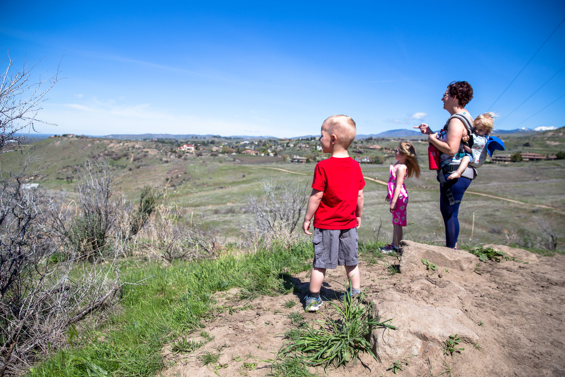 Mom and kids looking over the city as they hike up Table Rock