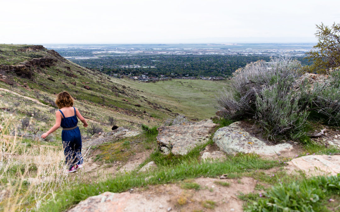 Girl hiking around Table Rock and seeing the city view below